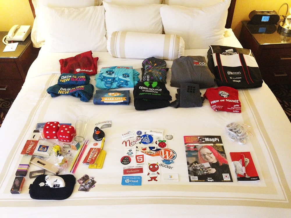 An image demonstrating how much merchandise a regular tradeshow attendee receives. Photo by Jeff Kramer via Flickr.